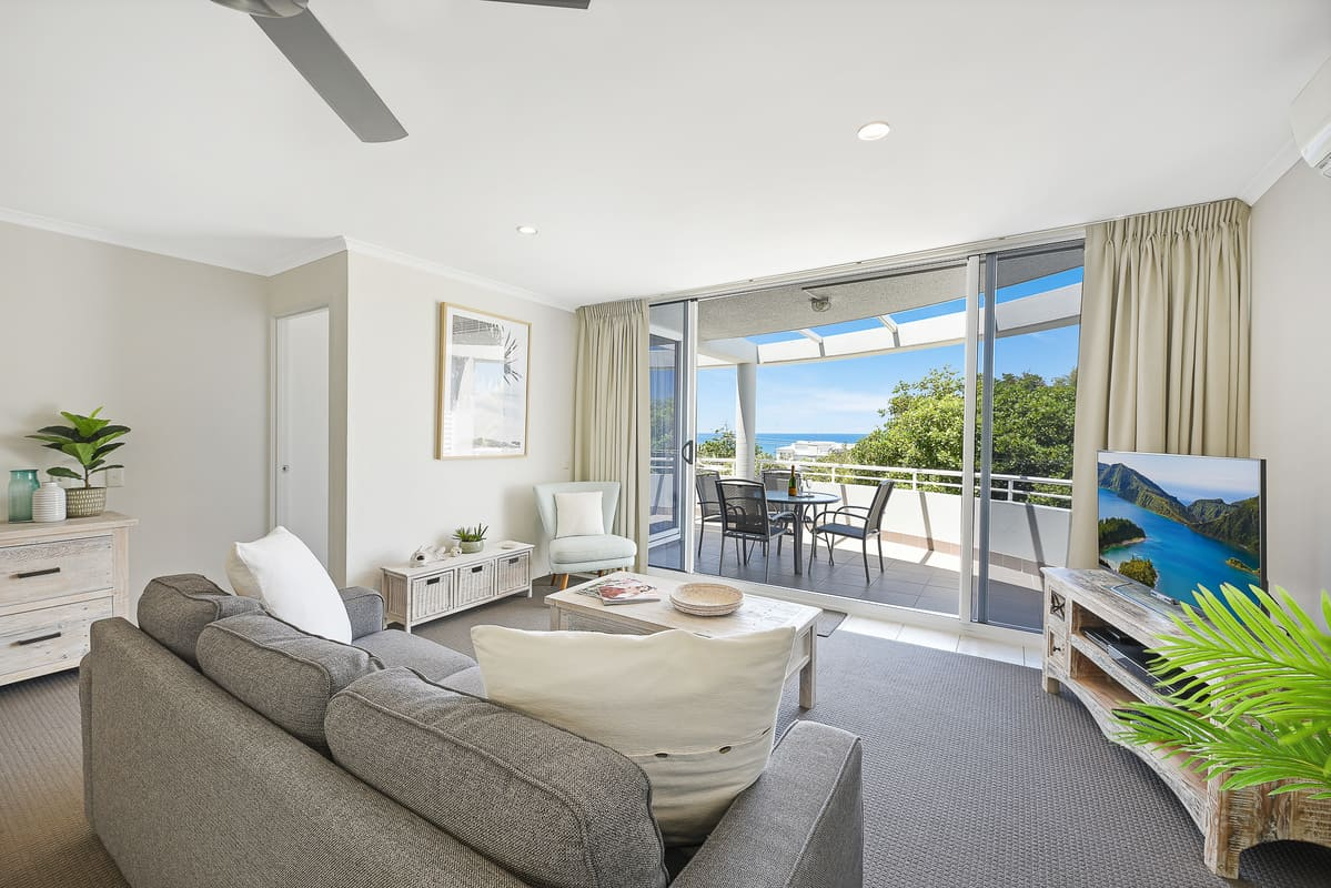 Comfortable Lounge Flows onto Deck with Sun Loungers, Outdoor Table and Blue Views. TV with Foxtel and DVD player