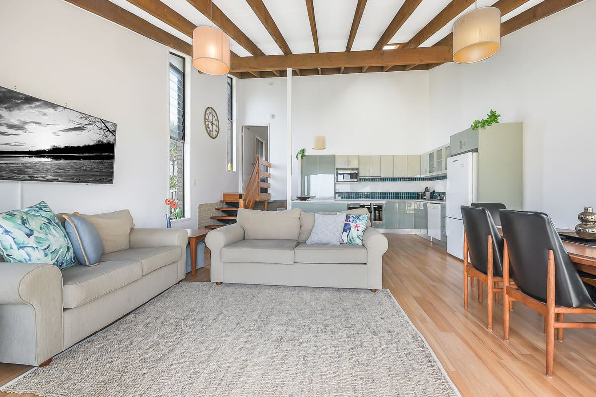 Open Plan Living with Large Smart TV and Dining Room which Flows onto Outdoor Balcony