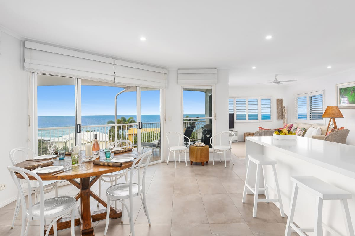 Open plan with modern kitchen lowing out to undercover balcony with amazing views.